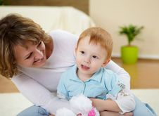 Mother And Son At Home On The Floor Stock Photos