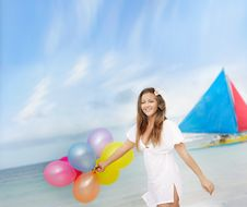 Free Woman With Balloons On Sea Background Royalty Free Stock Images - 18588799