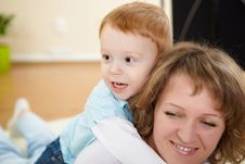 Mother And Son At Home On The Floor Stock Photography