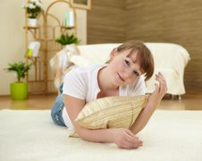 Free Young Woman Relaxing At Home On The Floor Stock Photography - 18589802
