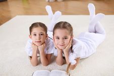 Free Twin Sisters Together At Home With Books Stock Photography - 18589892