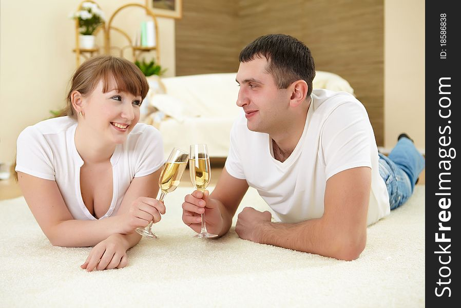 Couple at home drinking champagne