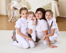 Free A Young Mother With Her Three Daughters At Home Royalty Free Stock Image - 18590056