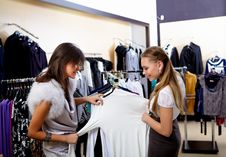 Free Young Woman In A Shop Buying Clothes Royalty Free Stock Photo - 18590785