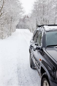 Free Car On A Snowy Forest Road Royalty Free Stock Photography - 18590797