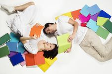 Free Couple Lying On Floor Reading And Looking Up. Royalty Free Stock Photos - 18595998