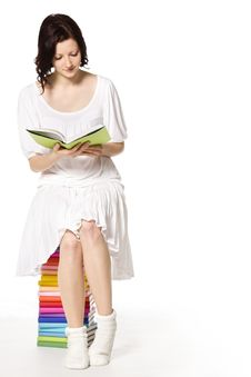 Free Girl On Book Stack Reading. Royalty Free Stock Photography - 18596117