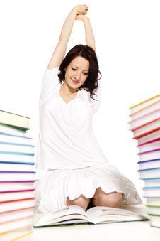 Girl Between Book Stacks Stretching.