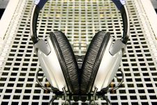 Free Symmetrical Silver Headphones On Silver Grid Background Stock Photo - 1868020