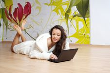 Free A Young Woman In A White Robe With Laptop Royalty Free Stock Image - 18603006