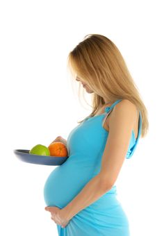 Pregnant  Holding An Apple And An Orange In A Pan Stock Image