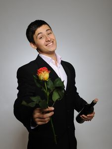 Free Handsome Man Holding Rose Flower And Vine Bottle Stock Photos - 18608603