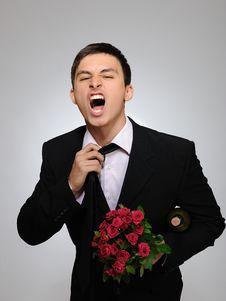 Handsome Man Holding Rose Flower And Vine Bottle Royalty Free Stock Image
