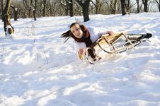 Free Girl Having Accident On Sledge Stock Images - 18613204