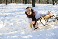 Free Woman Having Accident On Sledge Stock Photography - 18613222