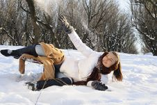 Free Girl Playing With Snow On Sledge Stock Photo - 18613480