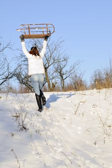 Free Woman Carrying Sledge Royalty Free Stock Photography - 18613537