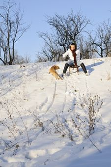 Free Girl Playing With Dog In Snow Stock Image - 18613731
