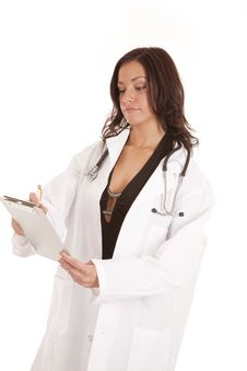 Free Woman Doctor Looking Down Writing Stock Photography - 18614392