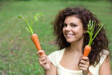 Free Woman With Pair Of Fresh Carrots. Stock Photo - 18615030