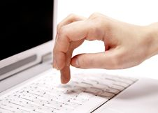 Free Human Hand Over Laptop Keypad During Typing. Royalty Free Stock Images - 18615279