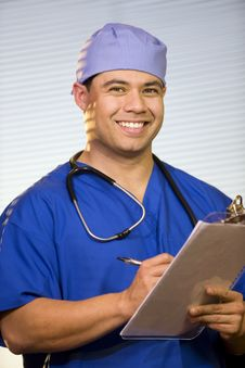 Free Hispanic Doctor In The Office Royalty Free Stock Photography - 18615307
