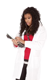 Free Woman Doctor Listening To Scales Stock Images - 18615634