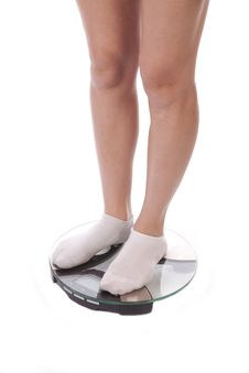 Free Woman In Socks Legs On Scales Royalty Free Stock Photos - 18615688