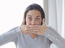Free Young Woman Covering Her Mouth With Both Hands Royalty Free Stock Photos - 18617198