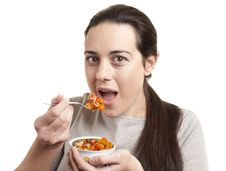 Free Portrait Of Young Happy Woman Eating Salad Stock Photography - 18617212