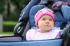 Pink Girl In Blue Pram Royalty Free Stock Images
