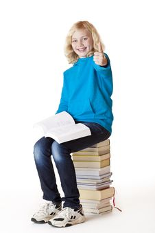 Free Happy Schoolgirl Sitting On Books Showing Thumb Stock Photo - 18624200