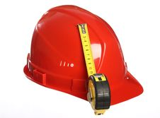Free Red Helmet And A Tape Measure Stock Photography - 18625592