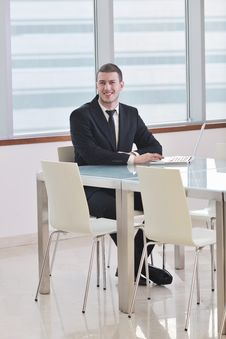 Free Young Business Man Alone In Conference Room Royalty Free Stock Photos - 18628848