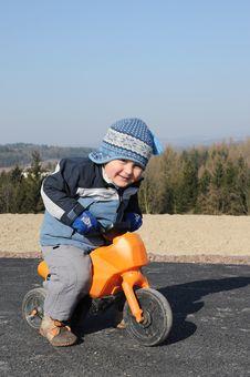 Child Riding Motorbike Stock Image