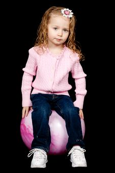 Content Girl Sitting On Her Ball Stock Photography