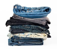 Stack Of Various Jeans Stock Photos