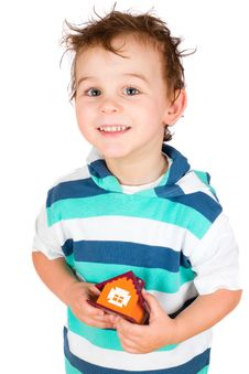 Free Smiling Boy Holding A Toy House Stock Photography - 18631692