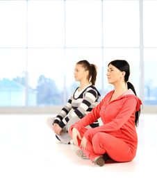 Two Girls Doing Yoga And Fitness Royalty Free Stock Photos