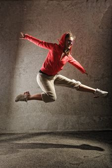 Free Young Female Dancing On The Grey Wall Royalty Free Stock Photos - 18634188