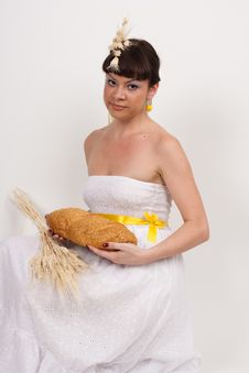 Free Girl With Bread And Ears Of Wheat Royalty Free Stock Photography - 18637667