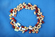 Pills Circle Shape On Blue Background Royalty Free Stock Image