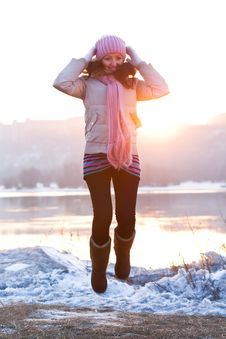Free Positive Smiling Girl In Winter Clothes - Jumping Royalty Free Stock Images - 18641829