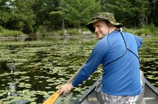 Man In Canoe Stock Images
