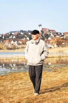 Senior Man Is Walking Stock Photography