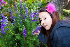 Young Woman Smell The Flowers Stock Photo