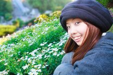 Free Young Woman Is Smiling In Front Of Garden Royalty Free Stock Photography - 18644997