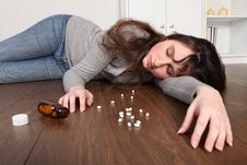 Young Woman Overdose On Pills Lying On Floor