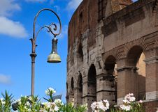 Free Ornate Street Lamp With Colosseum In Background Stock Images - 18647834