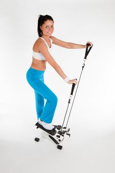 Free Woman Working Out On Stepper Trainer Royalty Free Stock Photography - 18656977